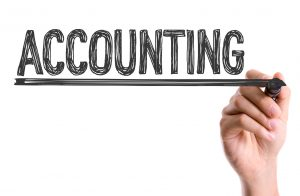 Hand with marker writing the word Accounting