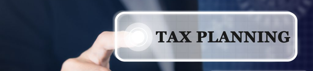 photo of a businessman pushing a button for tax planning services